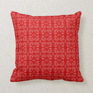 Pattern toned deep red pillow