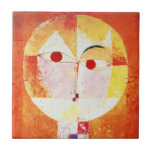 """Paul Klee Senecio Tile<br><div class=""""desc"""">Paul Klee Senecio tile. Oil painting on canvas from 1922. One of Paul Klee's most famous paintings, Senecio features an abstract face with offset red eyes on a fiery orange background. One of the most recognized cubist paintings from Klee's Bauhaus period, Senecio makes a great gift for fans of Paul...</div>"""