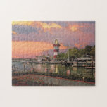 "Paul McGehee &quot;Hilton Head&quot; Jigsaw Puzzle<br><div class=""desc"">A beautiful jigsaw puzzle by the award-winning artist Paul McGehee. &quot;Hilton Head - Harbour Town at Sunset&quot; depicts South Carolina&#39;s premier island resort destination bathed in the dramatic colors of the setting sun. Hilton Head Island, located in Beaufort County (just a few miles from Savannah, Georgia) is one of the...</div>"