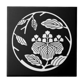Paulownia branch circle tile