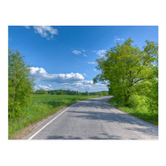 Paved road on a country side postcard