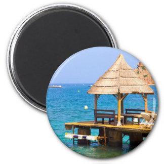 Pavilion in a beach 2 inch round magnet