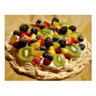 Pavlova garnished with colorful fruits postcard
