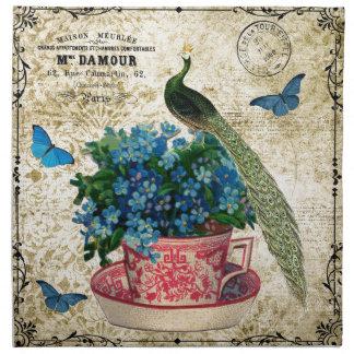 Pavo real del vintage en una taza de arte de la servilletas imprimidas