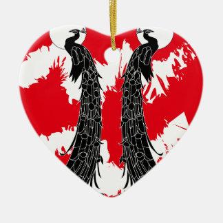 Pavo real negro adorno navideño de cerámica en forma de corazón