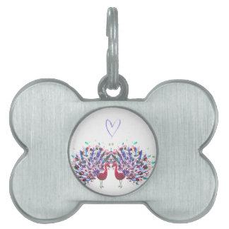 Pavos reales púrpuras con el watercolour del placa de mascota
