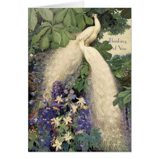 Pavos reales y flores blancos tarjetón