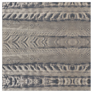 Paw prints and tire tracks on dirt road fabric
