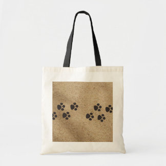 Paw prints in the sand bag