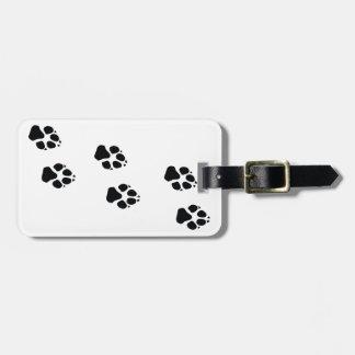 Paw prints of a dog bag tag