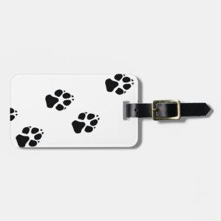 Paw prints of a dog luggage tag