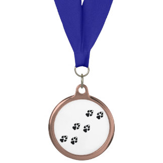 Paw prints of a dog medal