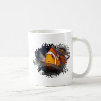 Payaso-pescados en anémona taza