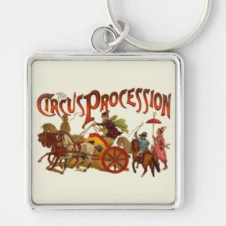 Payasos y caballos de la procesión del circo del v llavero