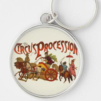 Payasos y caballos de la procesión del circo del v llaveros