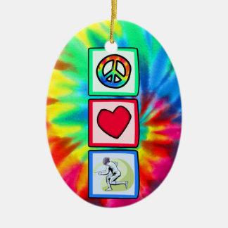 Paz, amor, cercando adorno navideño ovalado de cerámica