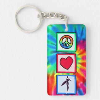 Paz, amor, chicas de la persona que practica surf llavero