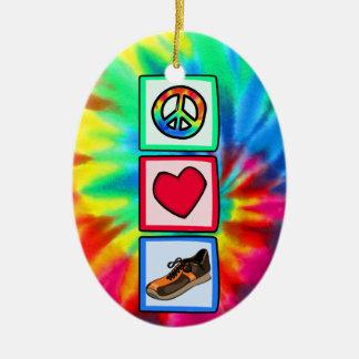 Paz, amor, corriendo adorno navideño ovalado de cerámica