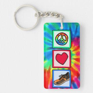Paz amor corriendo llaveros