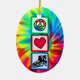 Paz, amor, hockey adorno navideño ovalado de cerámica