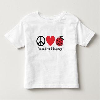 Paz, amor y mariquitas remeras