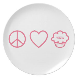 Paz, amor y placa de las magdalenas del vegano platos