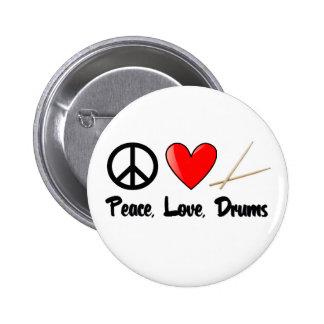 Paz, amor, y tambores pins