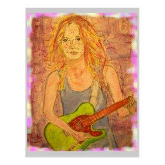 Paz del chica de la guitarra en la tierra postal