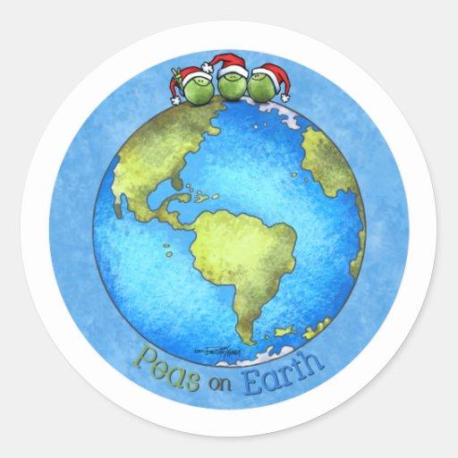 Paz del navidad en la tierra pegatina redonda