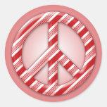 Paz en el bastón de caramelo de la tierra etiquetas redondas