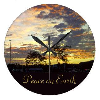 Paz en el reloj de pared de la tierra por