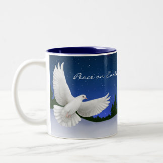 Paz en la taza de la paloma de la tierra