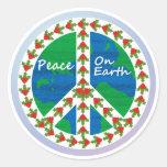 Paz en navidad de la tierra etiqueta redonda