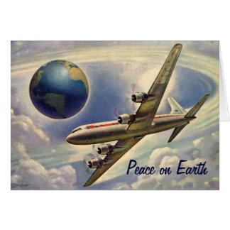 Paz en navidad de la tierra, mundo del aeroplano tarjeta de felicitación