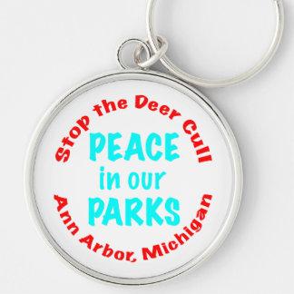 Paz en nuestros parques llavero redondo plateado