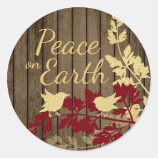 Paz en pájaros del arbolado de la tierra pegatina redonda