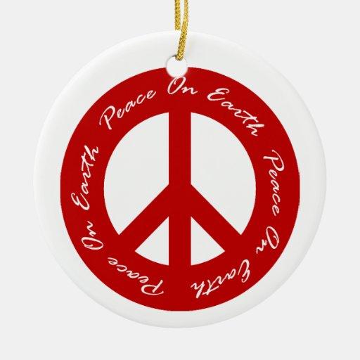Paz en signos de la paz rojos y verdes de la tierr ornamento de navidad
