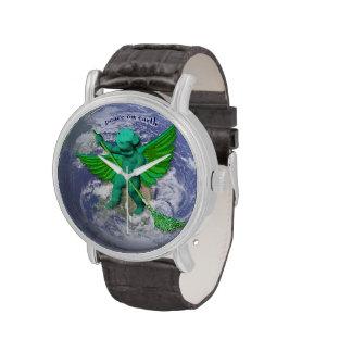 Paz verde del ángel en el reloj de la tierra