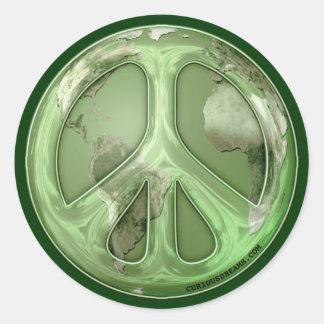 Paz verde en el pegatina de la tierra