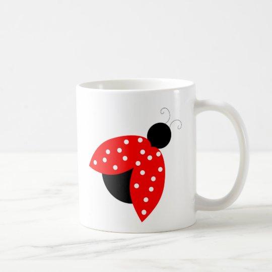 paz y alegría rojas del insecto de la señora taza de café