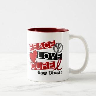 PEACE LOVE CURE HEART DISEASE COFFEE MUG
