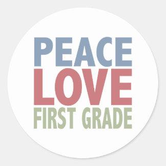 Peace Love First Grade Classic Round Sticker