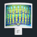 """""""Peace, Love &amp; Light"""" Blue Hanukkah Menorah Photo Night Light<br><div class=""""desc"""">""""Peace, love &amp; light."""" A close-up photo of a bright, colorful, blue and green artsy menorah helps you usher in the holiday of Hanukkah in style. Feel the warmth and joy of the holiday season whenever you use this stunning, colorful Hanukkah night light. Also, matching cards, stickers, totebags, and other...</div>"""