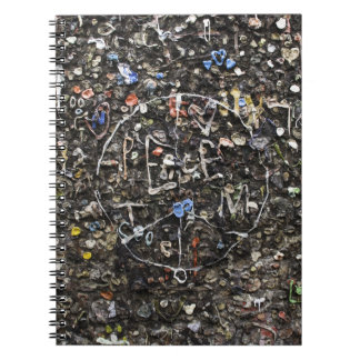 Peace sign in bubble gum on wall notebook