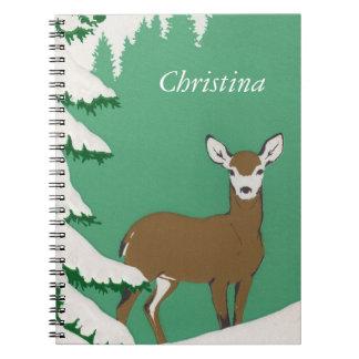 Peaceful brown Deer by Snow Covered Pine Tree Notebook