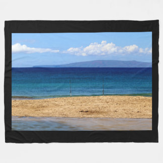 Peaceful picture of fishing rods on a beach, Maui Fleece Blanket