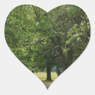 Peaceful treeline road heart sticker