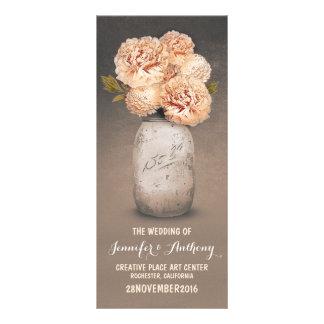 Peach painted mason jar wedding programs