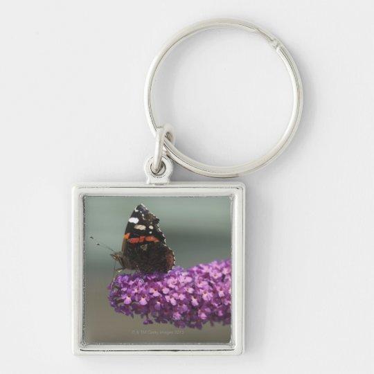 Peacock butterfly on flower keychain