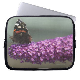 Peacock butterfly on flower laptop sleeve